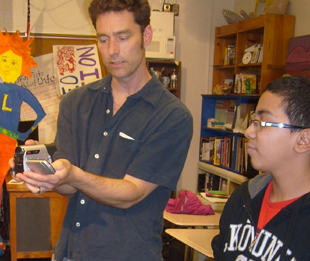 Instructor teaching student about working with video cameras